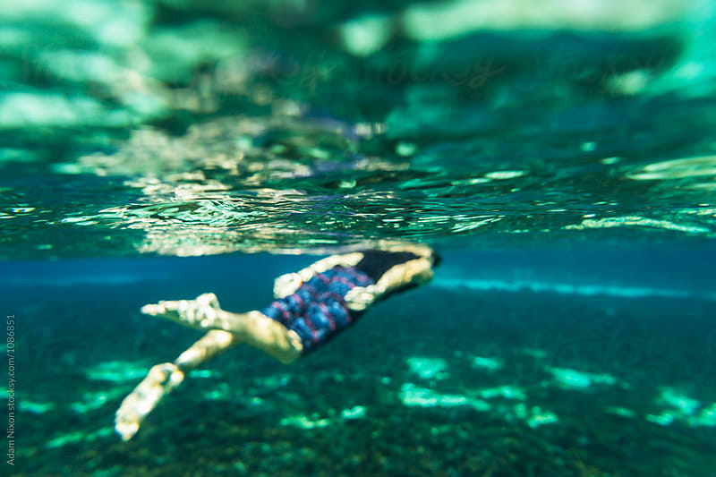 A teenager snorkeling in a fresh water spring in Florida, out of focus by Adam Nixon for Stocksy United