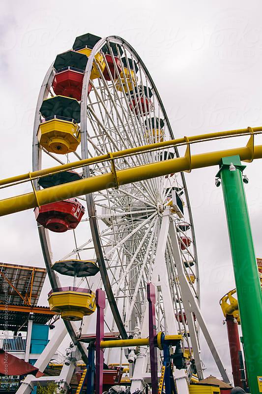 Ferris wheel on a fair by Alejandro Moreno de Carlos for Stocksy United