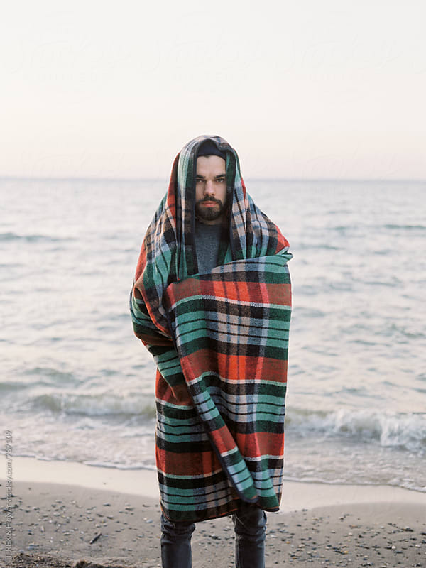 Man standing wrapped by Danil Nevsky for Stocksy United
