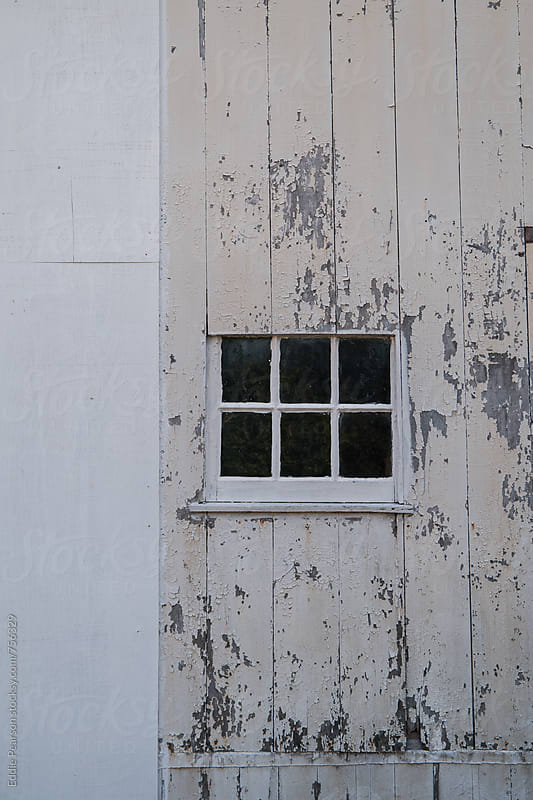 Empty window on a barn by Eddie Pearson for Stocksy United