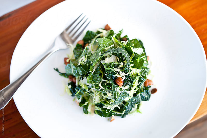 Fresh Kale and Brussel Sprout Salad by Lindsay Upson for Stocksy United