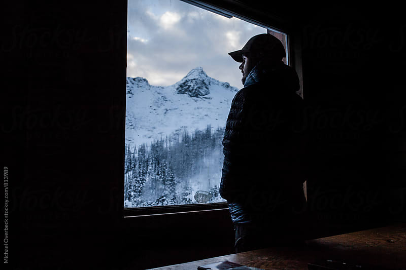 Looking out at Winter by Michael Overbeck for Stocksy United
