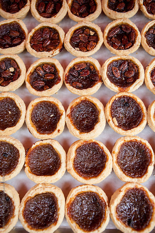 Butter tarts and Pecan tarts by Mental Art + Design for Stocksy United