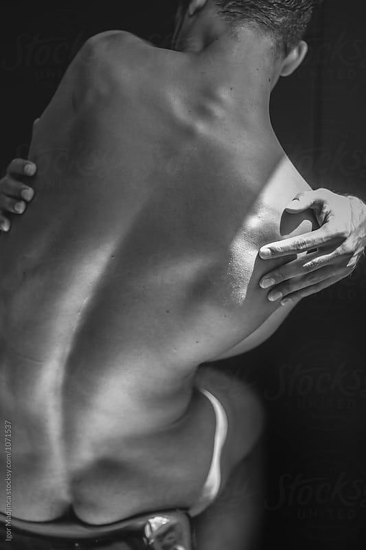 artistic,the body of a handsome male dancer by Igor Madjinca for Stocksy United