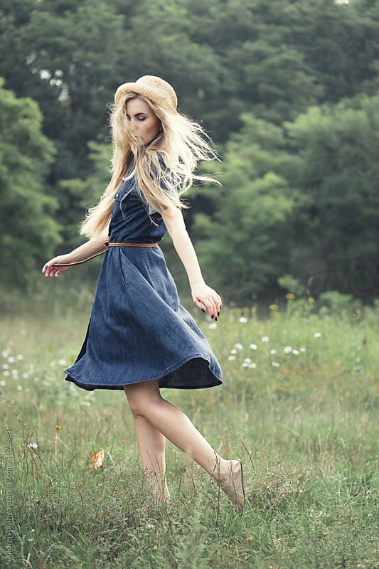 beautiful young girl in a dress running on field by Andrei Aleshyn for Stocksy United