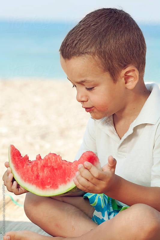 Child Eating Watermelon by Dejan Ristovski for Stocksy United