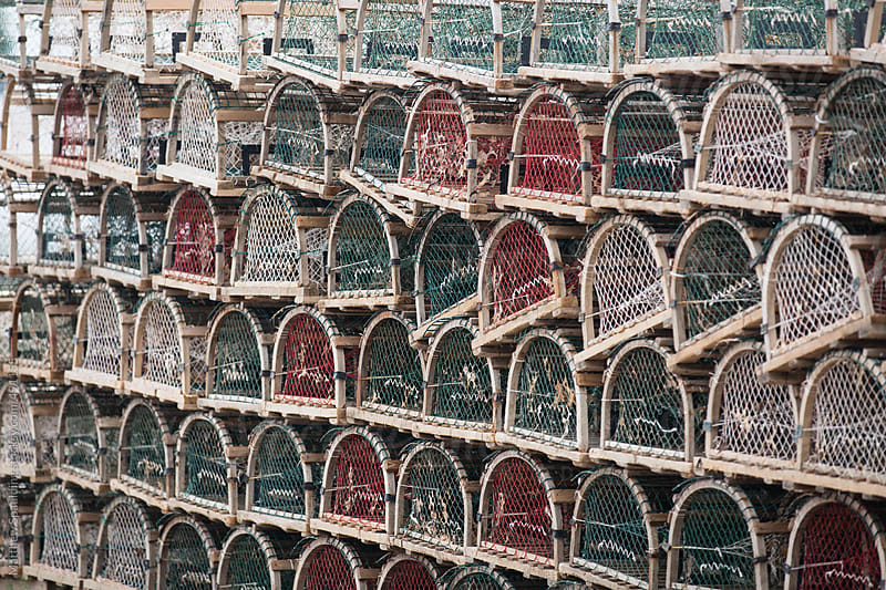 Rows of empty lobster pots on seaside dock by Matthew Spaulding for Stocksy United