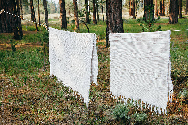 Laundry hanging to dry outside mountain cabin by Paul Edmondson for Stocksy United