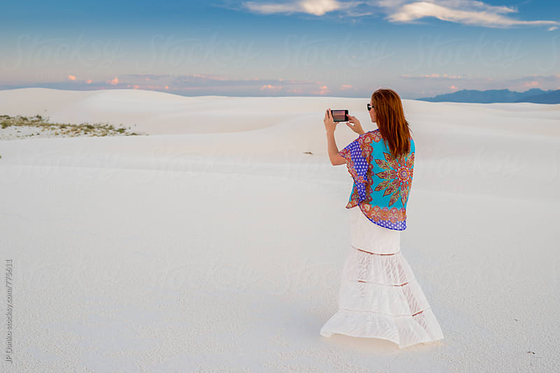 Woman Taking Photo With Phone of White Sand Dunes In White Sands National Monument New Mexico by JP Danko for Stocksy United