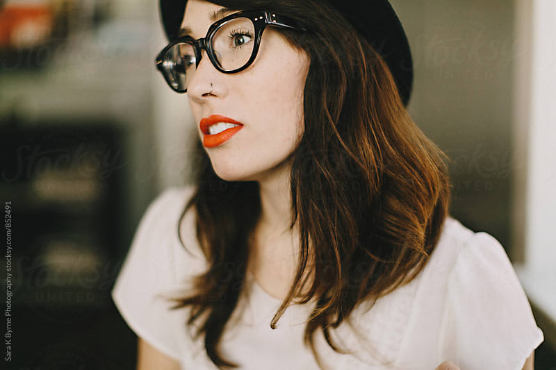 Hats and lipstick by Sara K Byrne Photography for Stocksy United