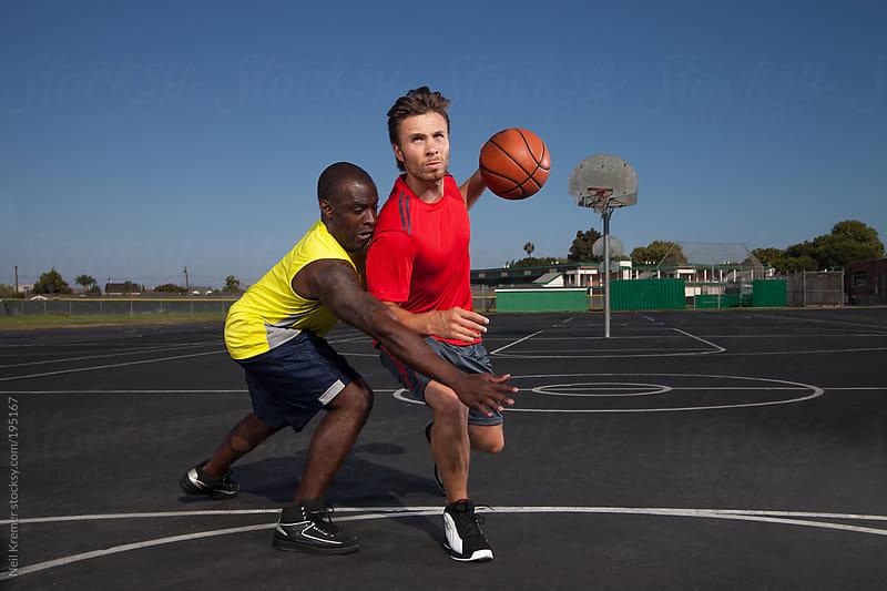 men playing basketball by Neil Kremer for Stocksy United