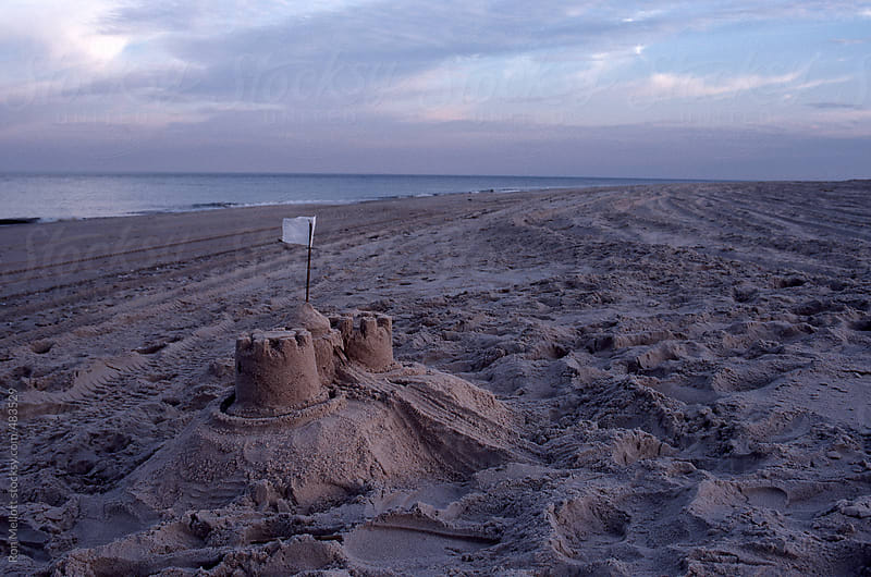 sand castle on beach by Ron Mellott for Stocksy United