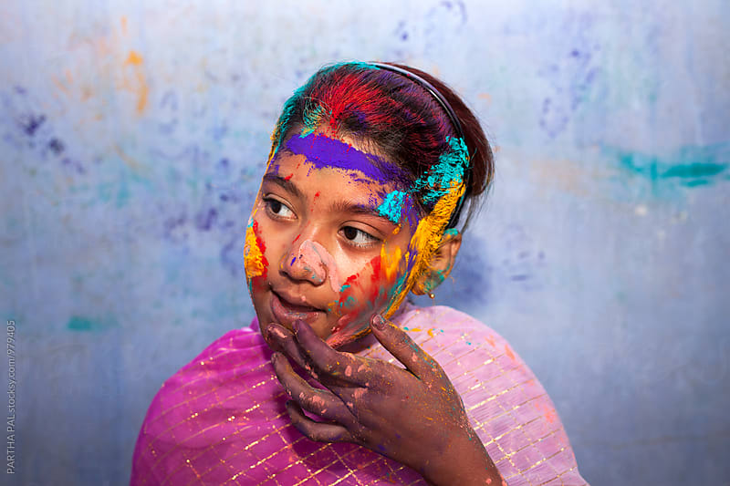 Portrait of a girl with color powder in her face by PARTHA PAL for Stocksy United
