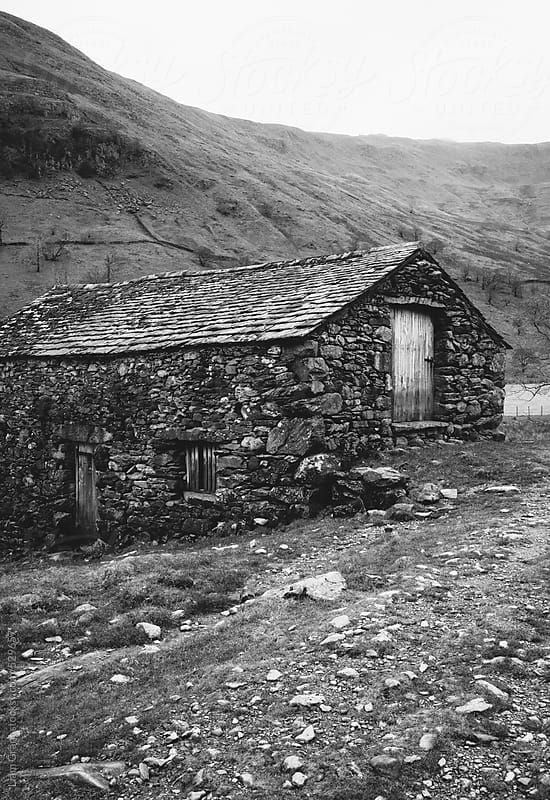 Old stone barn on a remote hillside. by Liam Grant for Stocksy United