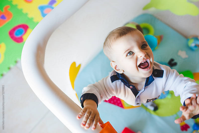 Fun laughing baby by michela ravasio for Stocksy United