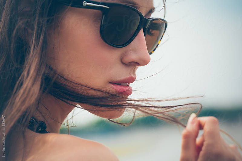 Portrait of a Woman With Sunglasses by Lumina for Stocksy United