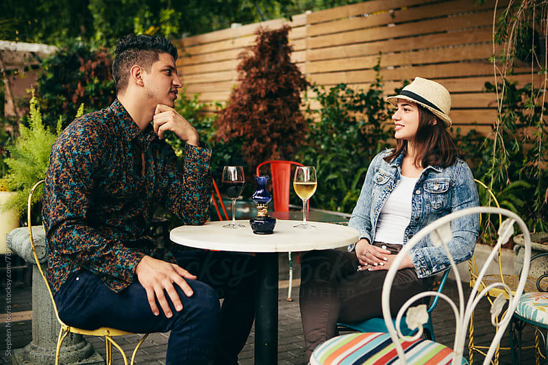 Young couple drinking wine by Stephen Morris for Stocksy United