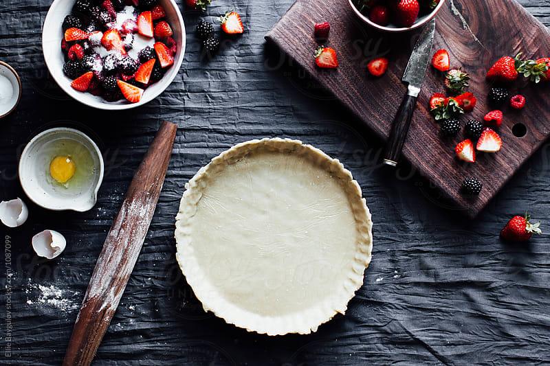 Berry pie prep by Ellie Baygulov for Stocksy United