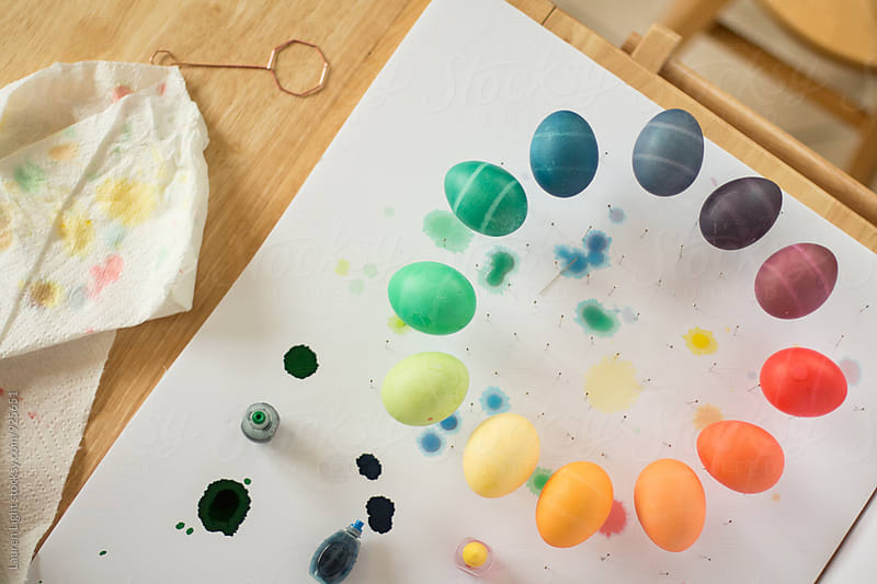 Colorful dyed easter eggs and dyeing supplies by Lauren Light for Stocksy United