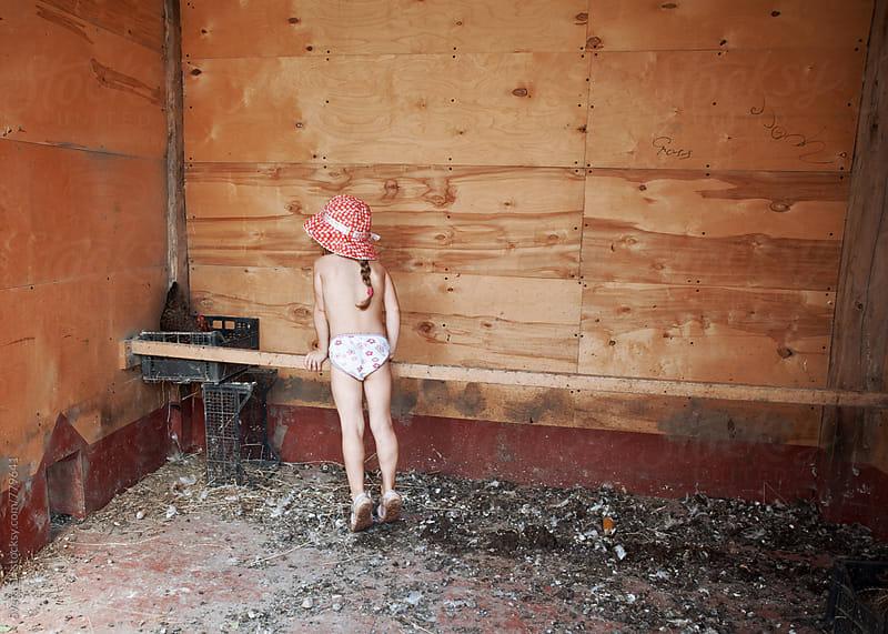 Little girl in a henhouse. by Svetlana Shchemeleva for Stocksy United