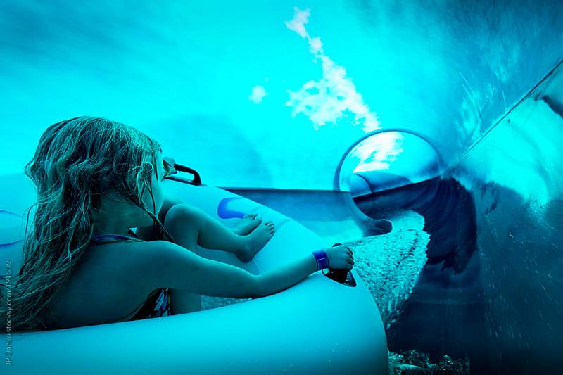 Little Girl Sliding Down Giant Blue Water slide at Amusement Park by JP Danko for Stocksy United