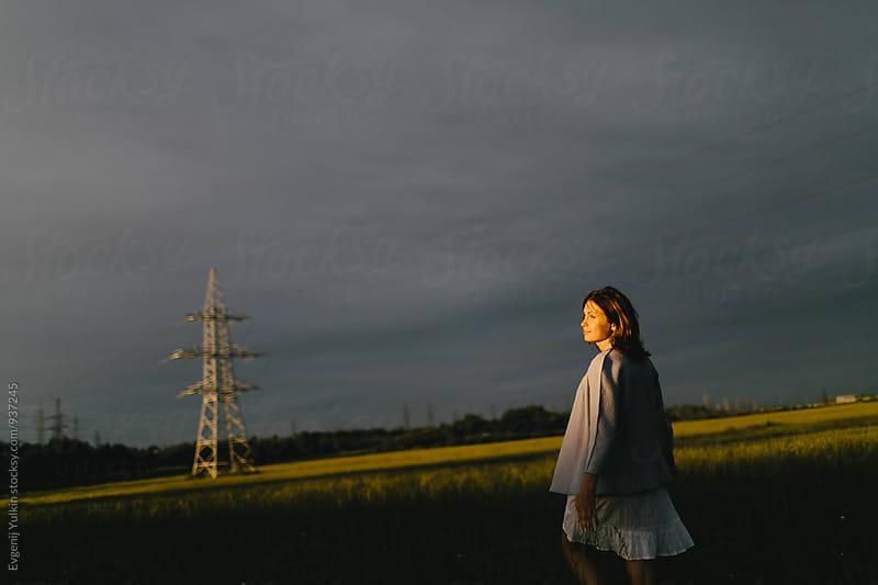 Pregnant female enjoying the sun on the open air by Evgenij Yulkin for Stocksy United