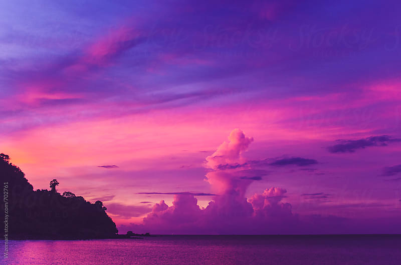 Beautiful, serene, tropical, purple sunset over Thailand's islands by Wizemark for Stocksy United
