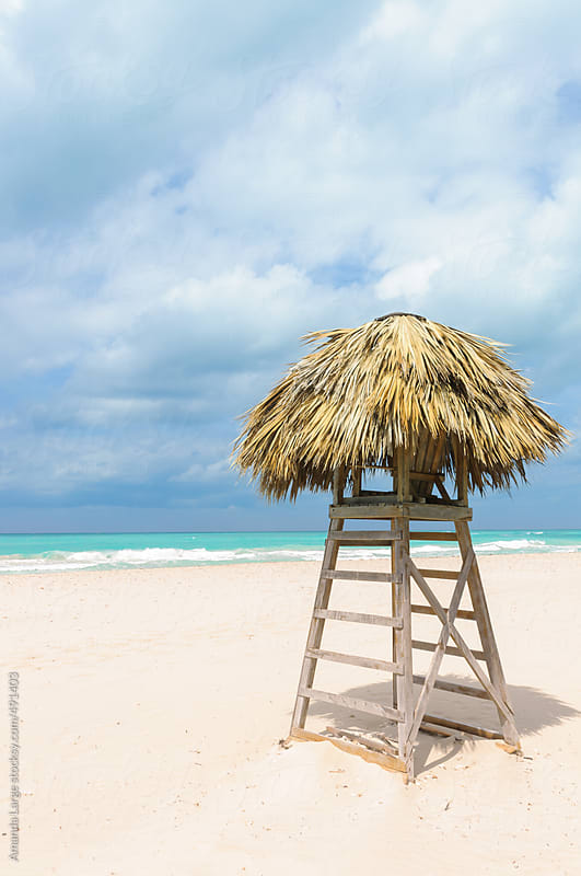 Thatched lifeguard tower on a tropical beach  by Amanda Large for Stocksy United