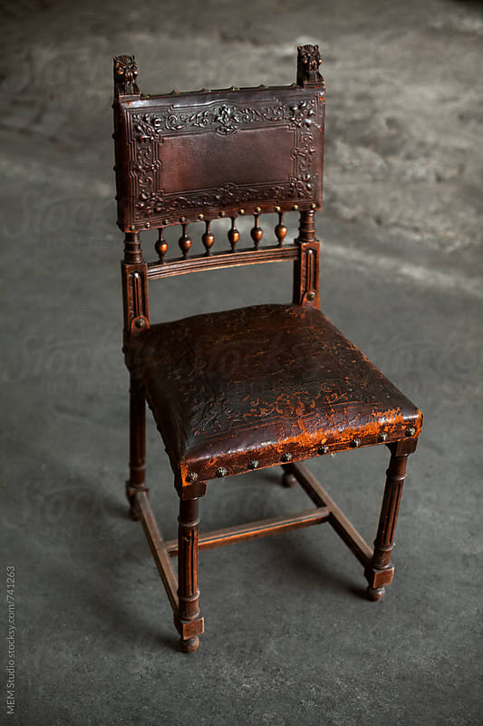 old wooden chair with leather upholstery by MEM Studio for Stocksy United
