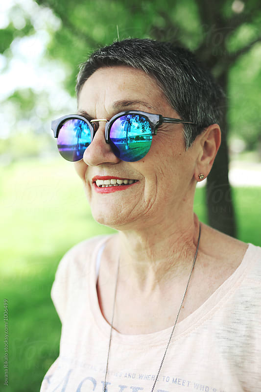 Trendy elderly woman wearing sunglasses by Jovana Rikalo for Stocksy United
