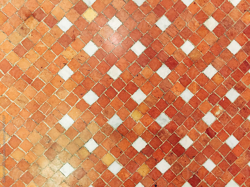 Peach color mosaic pattern on a floor by Gabriel (Gabi) Bucataru for Stocksy United