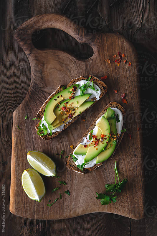 Avocado and sour cream toasts by Pixel Stories for Stocksy United