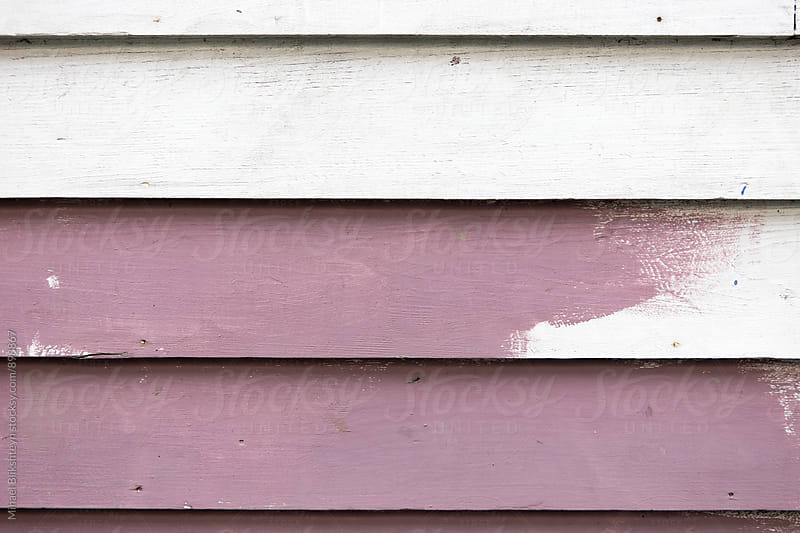 Closeup of white and purple panels of a painted wall by Mihael Blikshteyn for Stocksy United