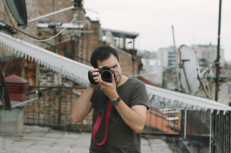 Portrait of a handsome male model with camera by Evil Pixels  Photography for Stocksy United