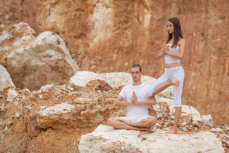 Man and Woman Doing Yoga in Nature by Mosuno for Stocksy United