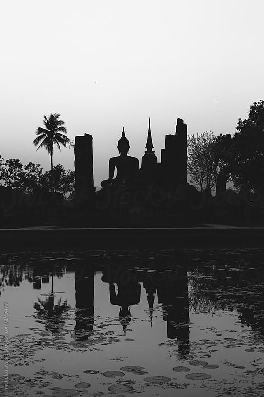 Silhouette of ancient temple with a statue of Buddha by michela ravasio for Stocksy United