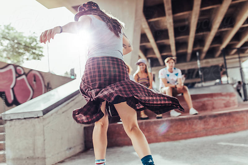 Girl skateboarding at skate park by Jacob Ammentorp Lund for Stocksy United
