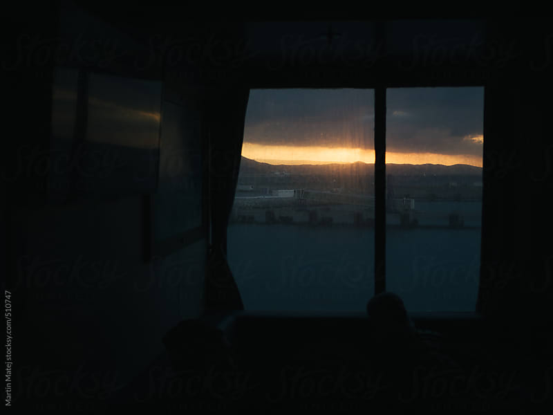 Sunset behind squared window in ferry by Martin Matej for Stocksy United