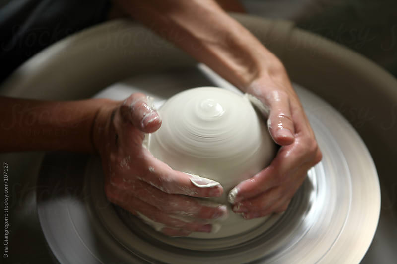 Ceramicist using pottery wheel to shape clay by Dina Giangregorio for Stocksy United