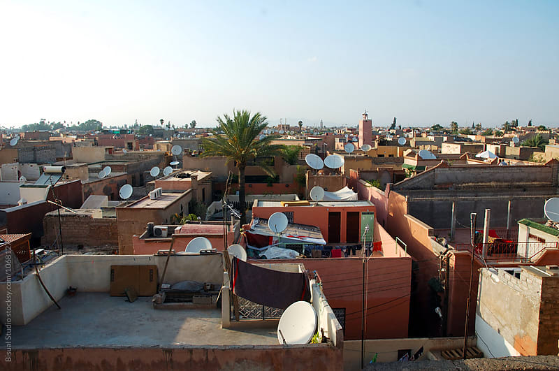 Multiple satellite dishes above the roofs of the medina, Marrakech by Bisual Studio for Stocksy United
