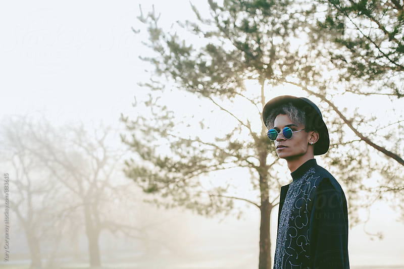 Portrait of young man in a hat and glasses in the trees by Юрий Горяной for Stocksy United