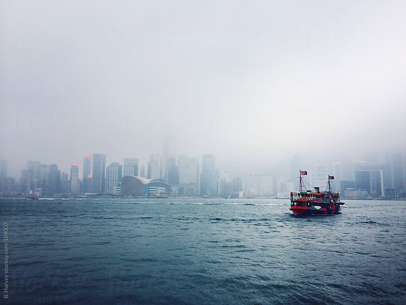 Chinese Boat in Front of Hong Kong by B. Harvey for Stocksy United