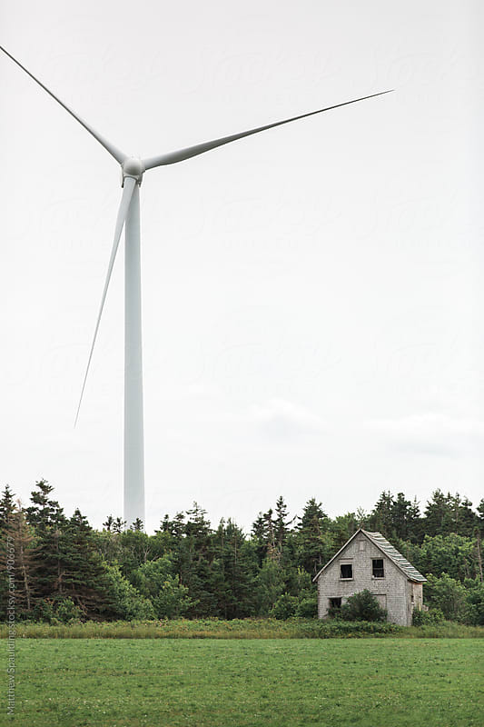 Windmill for sustainable renewable energy in rural Canada by Matthew Spaulding for Stocksy United