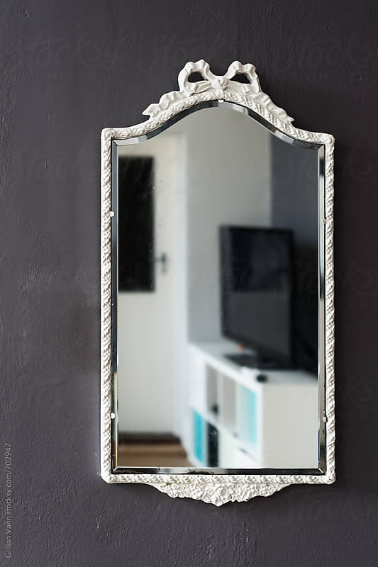 diy project: giving an old mirror a new look, the after shot by Gillian Vann for Stocksy United