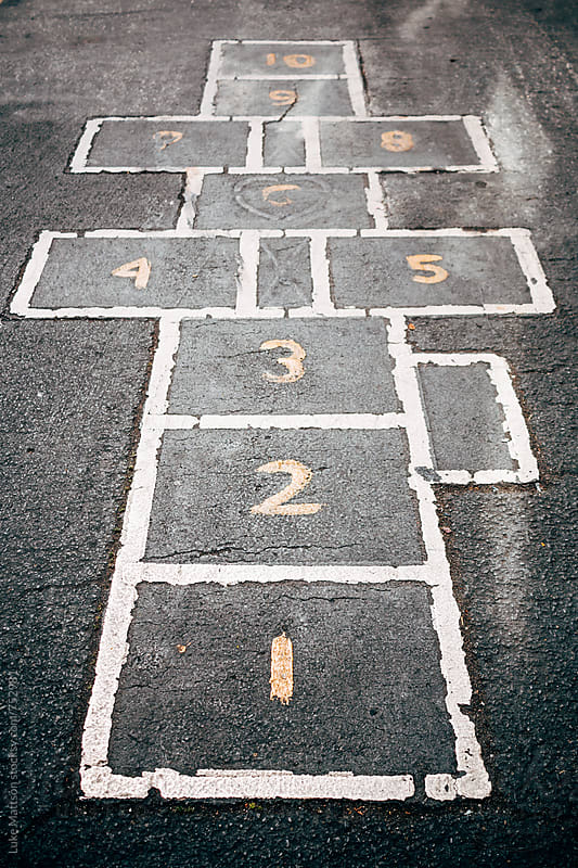 Numbered Hopscotch Squares On School Asphalt Playground  by Luke Mattson for Stocksy United