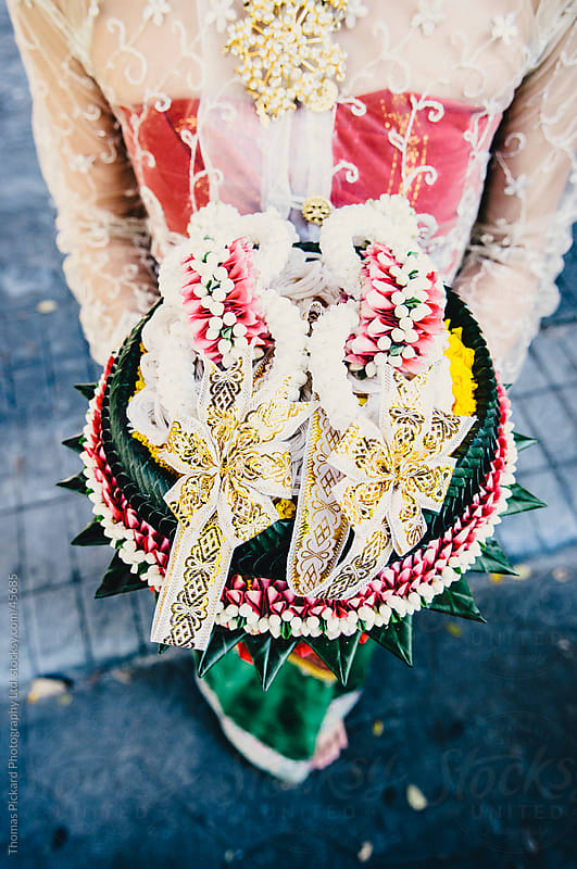 Woman holding a tray with ceremonial Thai wedding decorations, Thailand. by Thomas Pickard Photography Ltd. for Stocksy United