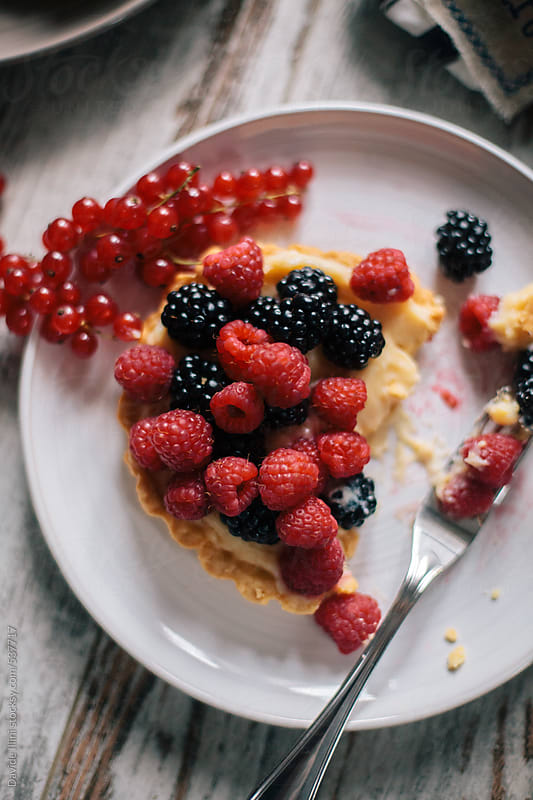 Tart with fresh berries by Davide Illini for Stocksy United