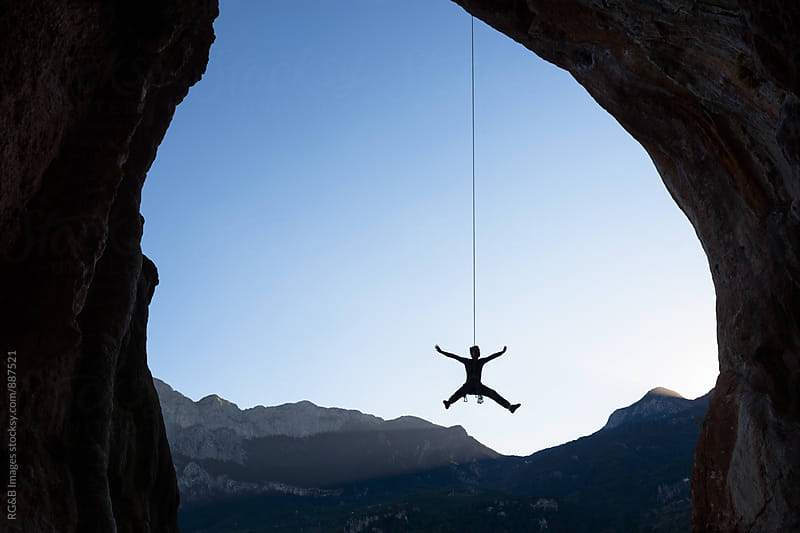 Climber silhouette rope swinging at dawn by RG&B Images for Stocksy United