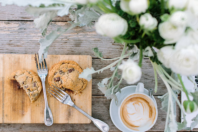 Chocolate chip cookies with a cappuccino by Kristen Curette Hines for Stocksy United