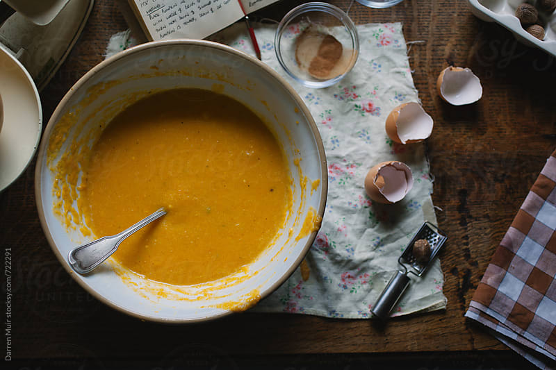 Pumpkin pie mix in a bowl, on a table. by Darren Muir for Stocksy United